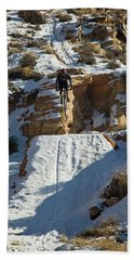 Mountain Biker Jumping With Snowy Hand Towel