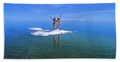 Nude Young Couple Playing On An Ice Bath Towel