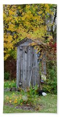 Outhouse Surrounded By Autumn Leaves Hand Towel