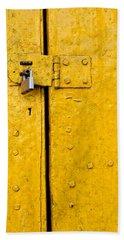 Padlock On An Old Yellow Door Bath Towel