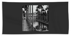 Palm Trees Bordering A Pool Hand Towel