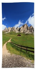 Hand Towel featuring the photograph path in Gardena pass by Antonio Scarpi
