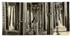 Peeking Under The Pier By Diana Sainz Bath Towel