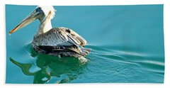 Hand Towel featuring the photograph Pelican Swimming by Clare Bevan