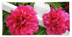 Hand Towel featuring the photograph Peonies Resting On White Fence by Barbara Griffin