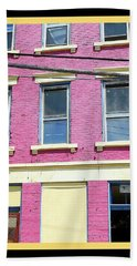 Bath Towel featuring the photograph Pink Yellow Blue Building by Kathy Barney