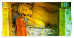 praying buddhist monk by a lying buddha in Sri Lanka Hand Towel