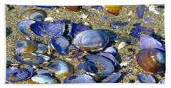 Purple Clam Shells On A Beach Bath Towel by Sharon Talson