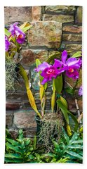 Purple Orchids With Cultured Stone Background Hand Towel