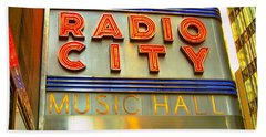 Bath Towel featuring the photograph Radio City Music Hall by Judy Palkimas