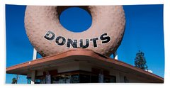 Randy's Donuts Bath Towel by Stephen Stookey