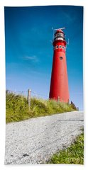 Red Lighthouse And Deep Blue Sky. Hand Towel