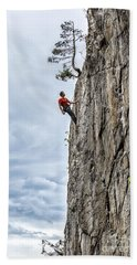 Hand Towel featuring the photograph Rock Climber by Carsten Reisinger