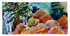 Rocks Near Red Feather Bath Towel