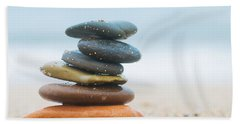 Stack Of Beach Stones On Sand Hand Towel