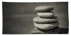 Stacked Pebbles On Beach Hand Towel