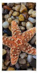 Starfish On Rocks Hand Towel