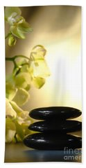 Stone Cairn And Orchids Hand Towel