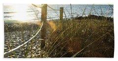 Sun Glared Grassy Beach Posts Hand Towel