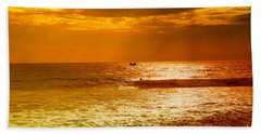 sunset in gold and red at the Hikkaduwa beach Hand Towel