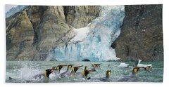 Swimmings King Penguins And Glacier Hand Towel by Yva Momatiuk John Eastcott