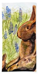 Hand Towel featuring the painting Terra Cotta Bunny Family by Angela Davies