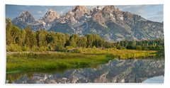 Teton Range Reflected In The Snake River Hand Towel by Jeff Goulden