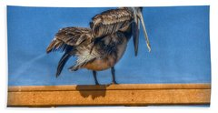 Hand Towel featuring the photograph The Pelican by Hanny Heim