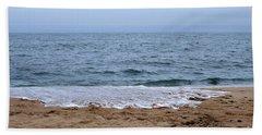 The Splash Over On A Sandy Beach Hand Towel
