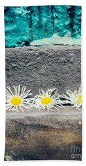 Bath Towel featuring the photograph Three Daisies Stuck In A Door by Silvia Ganora