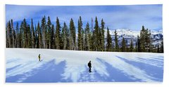 Tourists Skiing On Snow Covered Bath Towel