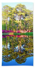 Tree Reflections And Pink Flowers By The Blue Water By Jan Marvin Studios Bath Towel