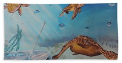 Turtles At Sea Hand Towel by Dianna Lewis