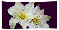 Two Clematis Flowers On Purple Bath Towel by Jane McIlroy