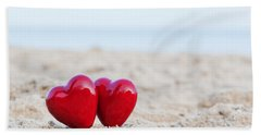 Two Red Hearts On The Beach Symbolizing Love Bath Towel