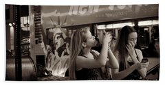 Hand Towel featuring the photograph Girls With Phones And Tourbus - Times Square by Miriam Danar