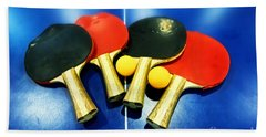 Vibrant Ping-pong Bats Table Tennis Paddles Rackets On Blue Bath Towel