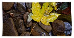 Wet Autumn Leaf On Stones Hand Towel