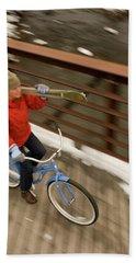 Woman Bikes Over Bridge With Skis Bath Towel