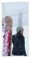 Woman Standing With Toboggan Sled Hand Towel