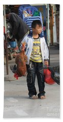Young Boy Carrying A Dead Chicken To School Bath Towel