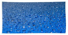 Water Drops On A Shiny Surface Hand Towel by Ulrich Schade