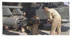 Aircrew Loading An Agm-114 Hellfire Bath Towel