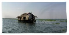 Bath Towel featuring the photograph A Houseboat Moving Placidly Through A Coastal Lagoon In Alleppey by Ashish Agarwal