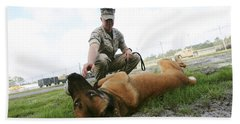 A Military Working Dog Handler Takes Hand Towel