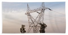 A Transmission Tower Carrying Electric Lines In The Countryside Hand Towel by Ashish Agarwal