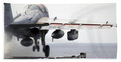 Airman Ducks Down As An Ea-6b Prowler Hand Towel