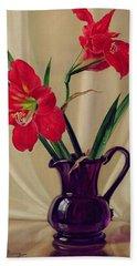 Amaryllis Lillies In A Dark Glass Jug Hand Towel