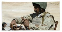 An Iraqi Army Soldier Prepares Belts Bath Towel