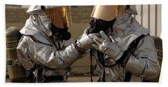 An Iraqi Firefighter Double Checks Hand Towel